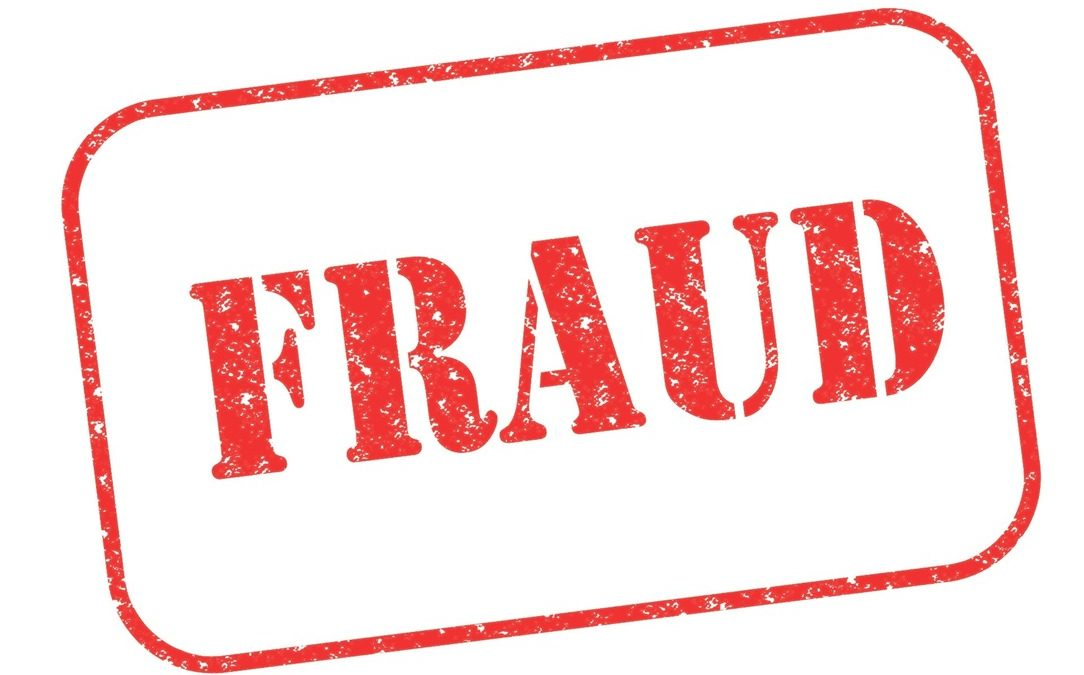 """Rubber stamp """"FRAUD"""" on white"""