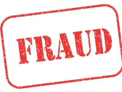"Rubber stamp ""FRAUD"" on white"